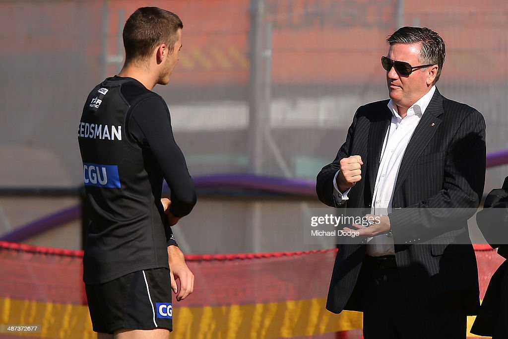 President Eddie McGuire talks to Paul Seedsman during a Collingwood Magpies AFL training session at the Westpac Centre on April 30 2014 in Melbourne...