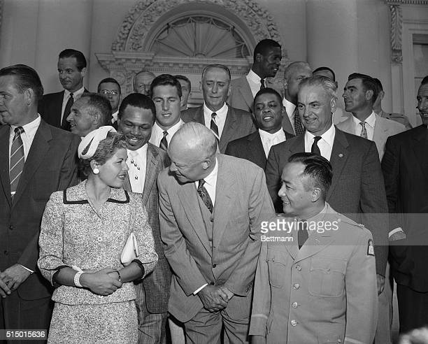 President Eisenhower is shown here chatting with Barbara Romack one of America's leading golfers as a group of the nation's outstanding sports...