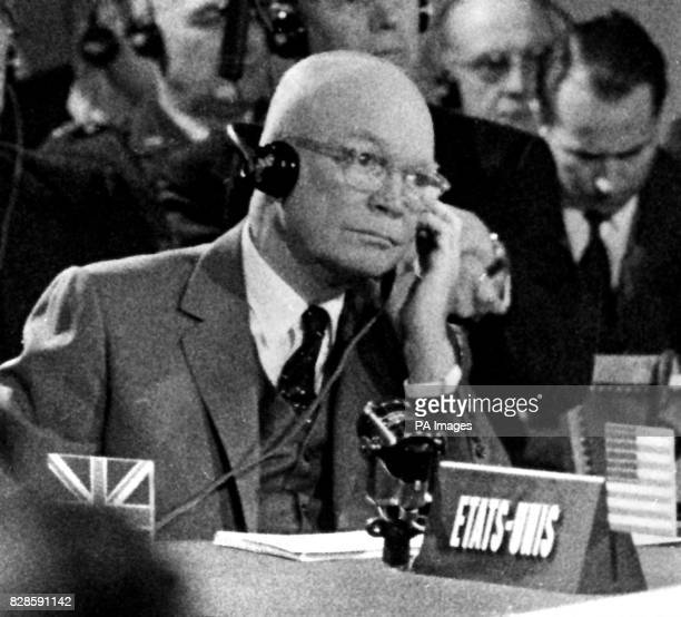President Eisenhower listens intently through headphones to the translation of the speech being made by the French Prime Minister M Felix Gaillard at...