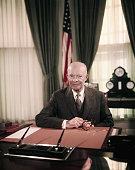 President Eisenhower Sitting at Desk in Oval Office