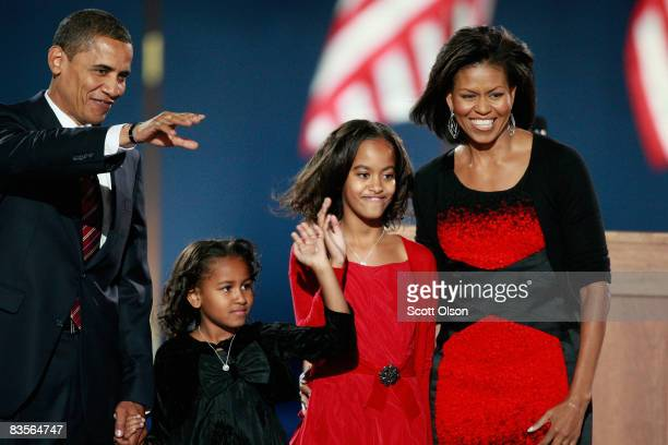 S President elect Barack Obama acknowledges his supporters along with his wife Michelle and daughters Malia and Sasha to during an election night...