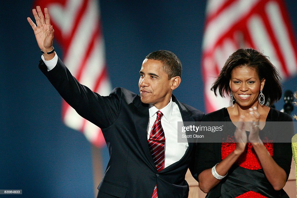 U.S. President elect Barack Obama and his wife Michelle acknowledge their supporters after Obama gave his victory speech during an election night gathering in Grant Park on November 4, 2008 in Chicago, Illinois. Obama defeated Republican nominee Sen. John McCain (R-AZ) by a wide margin in the election to become the first African-American U.S. President elect.