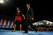 S President elect Barack Obama and his wife Michelle walk off the stage after Obama gave his victory speech during an election night gathering in...