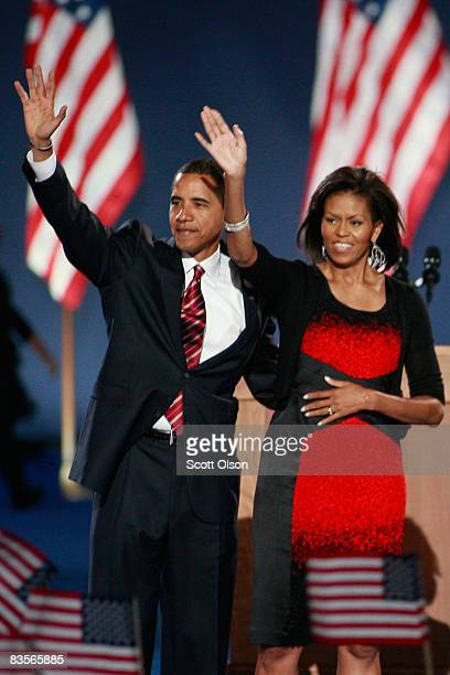 S President elect Barack Obama and his wife Michelle wave to their supporters after Obama gave his victory speech during an election night gathering...