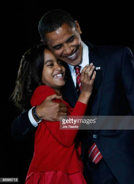 S President elect Barack Obama embraces his daughter Malia after Obama gave his victory speech during an election night gathering in Grant Park on...