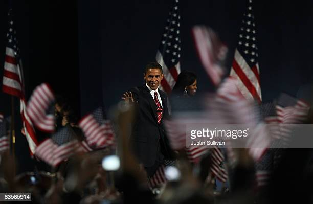 S President elect Barack Obama gestures on stage during an election night gathering in Grant Park on November 4 2008 in Chicago Illinois Obama...