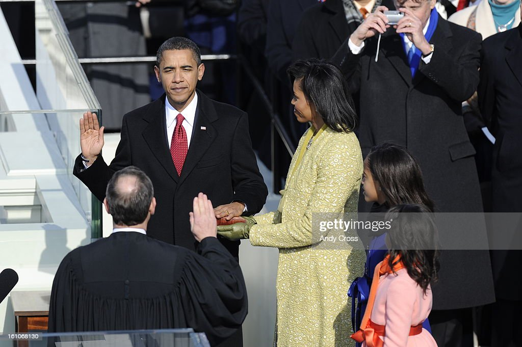 WASHINGTON DCJANUARY 20TH 2009 President Elect Barack Obama takes the Oath of Office from Chief Justice Roberts as his wife Michelle and his...