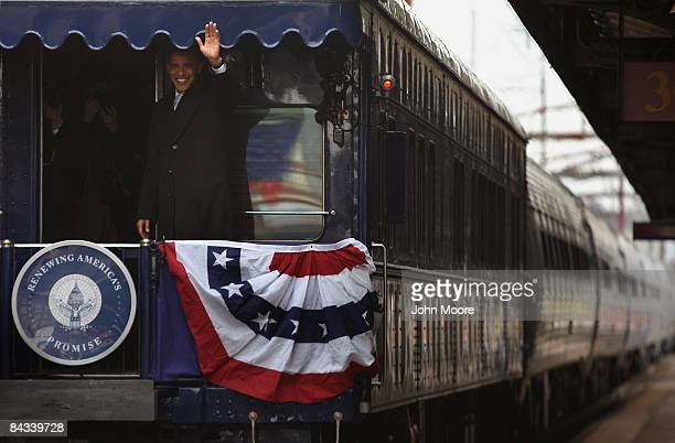 S President elect Barack Obama waves after boarding a Pullman Georgia 300 train with Vice Presidentelect Joseph Biden on January 17 2009 in...