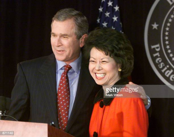 President elect George W Bush and Elaine Chao a former Peace Corps director and wife of GOP Senator Mitch McConnell smile at a press conference to...