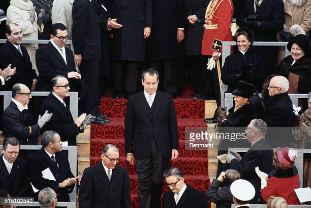 President elect Richard Nixon followed by Senator Everett Dirksen and Representative Gerald Ford arrives at Inaugural Stand January 20th where he was...