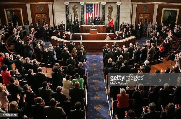President Ellen Johnson Sirleaf of the Republic of Liberia responds to applause as she arrives in the House Chamber to address a joint meeting of the...