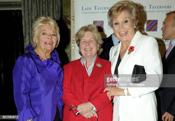 President Emeritus Judith Chalmers Sandy Toksvig and Angela Rippon pose during a tribute lunch hosted by The Lady Taverners at the Dorchester Hotel...