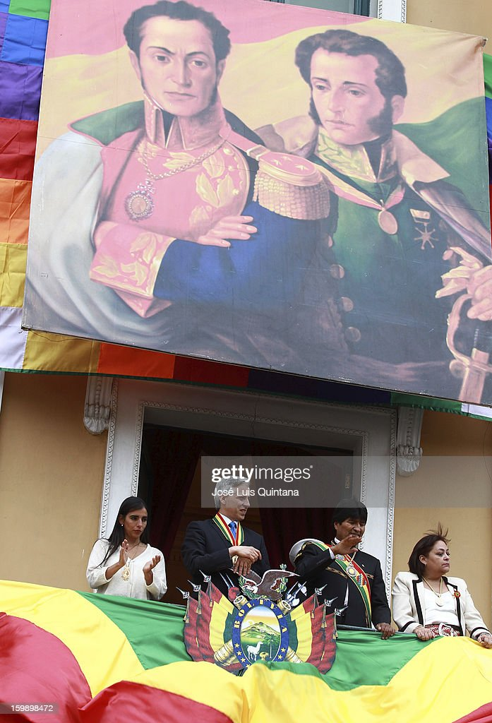 President Evo Morales and Vice President Álvaro García Linera salute from the balcony of the government palace Official to Social Organizations under the image of Antonio Jose de Sucre and Simon Bolivar during the celebration of the third anniversary of the founding of the Plurinational State of Bolivia on the January 22, 2013 in La Paz, Bolivia.