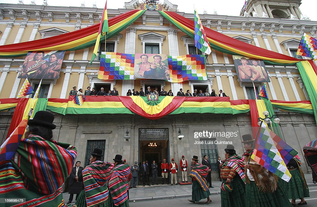 President Evo Morales and Vice President Álvaro García Linera salute from the balcony of the government palace Official to Social Organizations during the celebration of the third anniversary of the founding of the Plurinational State of Bolivia on the January 22, 2013 in La Paz, Bolivia.