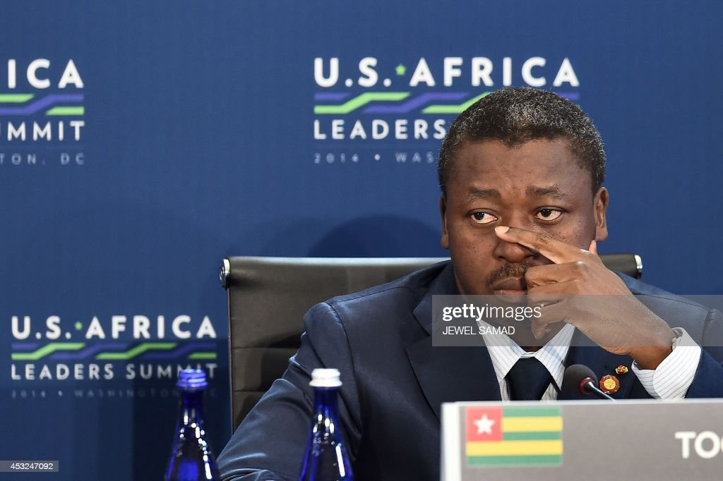 President Faure Essozimna Gnassingbe of Togo attends the 'Session 1- Investing in Africas Future' of the US-Africa Leaders Summit in Washington, DC, on August 6, 2014. Obama announced billions of dollars in investment for Africa, as the US challenges China and Europe's leading roles in the continent's economic emergence. But America's first black president urged African leaders to not let corruption or rebellions sidetrack their gains, as he pledged a new partnership at the landmark summit with African leaders. AFP PHOTO/Jewel Samad
