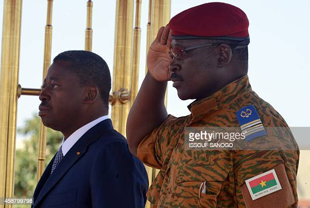 President Faure Gnassingbe of Togo and Burkina Faso's armyappointed leader LieutenantColonel Isaac Zida attends at Ouagadougou airport in Burkina...
