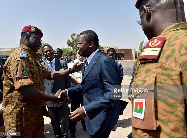President Faure Gnassingbe of Togo embraces Burkina Faso's armyappointed leader LieutenantColonel Isaac Zida at Ouagadougou airport on November 11...
