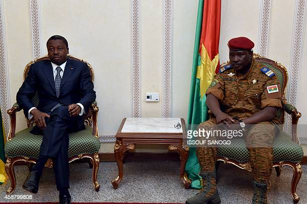 President Faure Gnassingbe of Togo sits with Burkina Faso's armyappointed leader LieutenantColonel Isaac Zida at Ouagadougou airport in Burkina Faso...