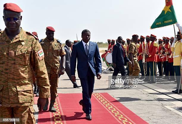 President Faure Gnassingbe of Togo walks with Burkina Faso's armyappointed leader LieutenantColonel Isaac Zida at Ouagadougou airport on November 11...