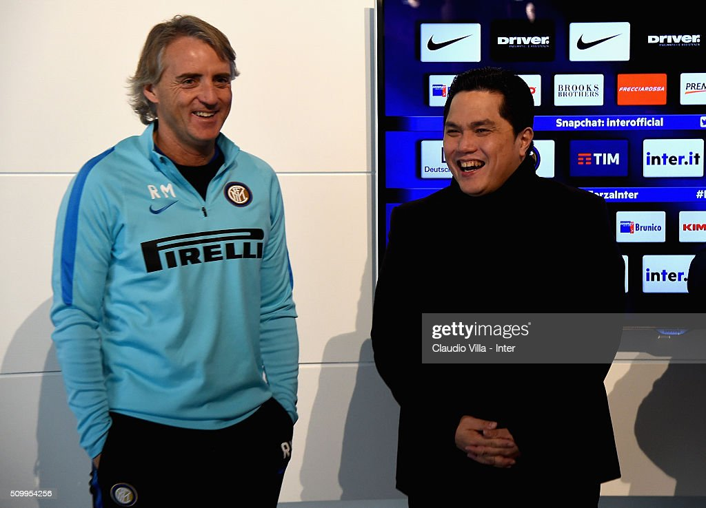 President FC Internazionale <a gi-track='captionPersonalityLinkClicked' href=/galleries/search?phrase=Erick+Thohir&family=editorial&specificpeople=9531719 ng-click='$event.stopPropagation()'>Erick Thohir</a> (R) and Head Coach <a gi-track='captionPersonalityLinkClicked' href=/galleries/search?phrase=Roberto+Mancini&family=editorial&specificpeople=234429 ng-click='$event.stopPropagation()'>Roberto Mancini</a> speak to the media during a press conference at the club's training ground at Appiano Gentile on February 13, 2016 in Como, Italy.