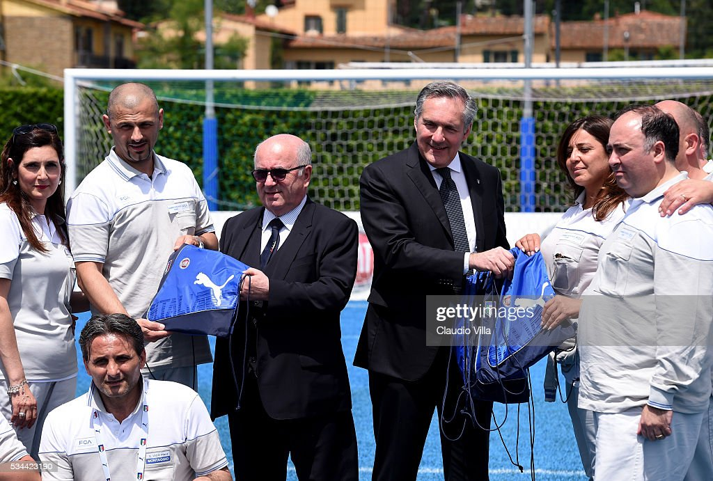 President FIGC <a gi-track='captionPersonalityLinkClicked' href=/galleries/search?phrase=Carlo+Tavecchio&family=editorial&specificpeople=5365308 ng-click='$event.stopPropagation()'>Carlo Tavecchio</a> (L) and COO FCA Alfredo Altavilla attend Unveil New Panda Azzurri Car at Coverciano on May 26, 2016 in Florence, Italy.