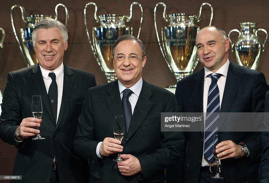 President Florentino Perez poses with head coach Carlo Ancelotti and basketball head coach Pablo Laso during a Real Madrid Christmas portrait session...
