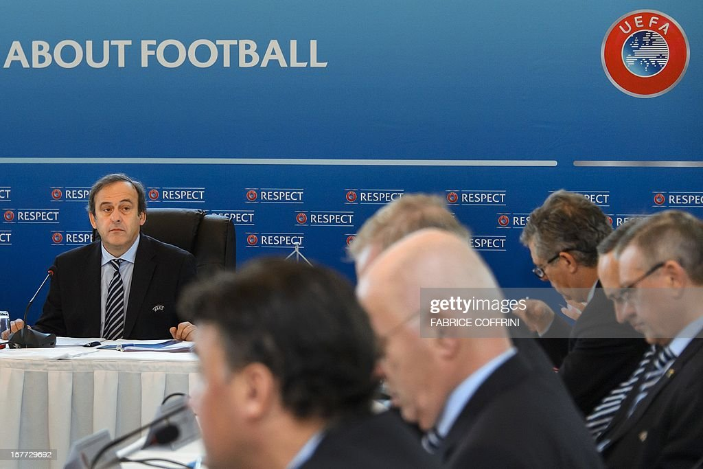 UEFA president France's Michel Platini (L) faces executive members of the football's European governing body during the year's last meeting on December 6, 2012 in Lausanne. Platini and his executive council will make a decision whether to push ahead with the concept of changing tradition and hosting Euro 2020 across a number of European cities. The Frenchman first proposed the idea on the eve of the Euro 2012 final between eventual champions Spain and Italy.