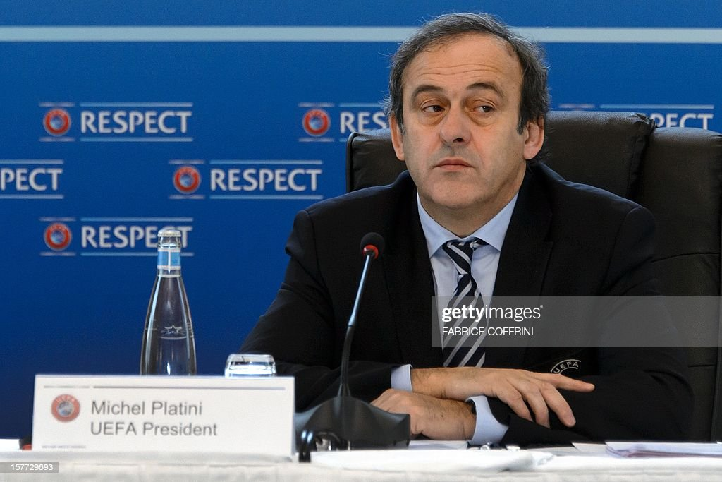 UEFA president France's Michel Platini looks on during the year's last meeting football's European governing body on December 6, 2012 in Lausanne. Platini and his executive council will make a decision whether to push ahead with the concept of changing tradition and hosting Euro 2020 across a number of European cities. The Frenchman first proposed the idea on the eve of the Euro 2012 final between eventual champions Spain and Italy. AFP PHOTO / FABRICE COFFRINI