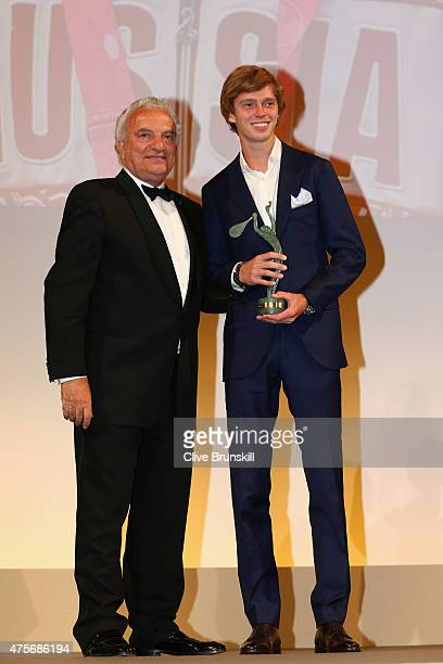 President Francesco Ricci Bitti poses with Andrey Rublev of Russia at the ITF World Champions Gala Dinner after day ten of the 2015 French Open at...