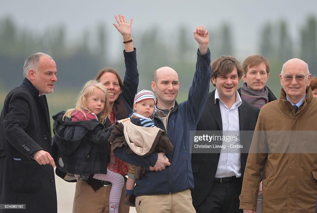 President Francois Hollande Foreign MInister Laurent Fabius welcome the four french hostages Edouard Elias Didier Franois and Pierre Torres while...