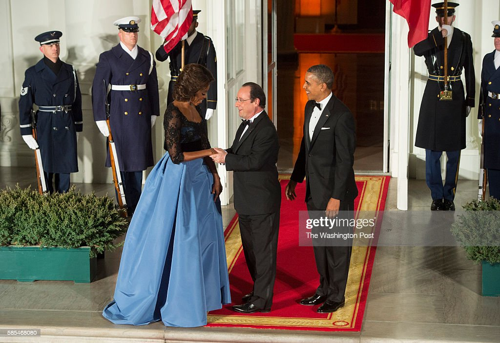 President Francois Hollande of France are greeted by First Lady Michelle Obama and President Barack Obama as he arrives at the North Portico for a...