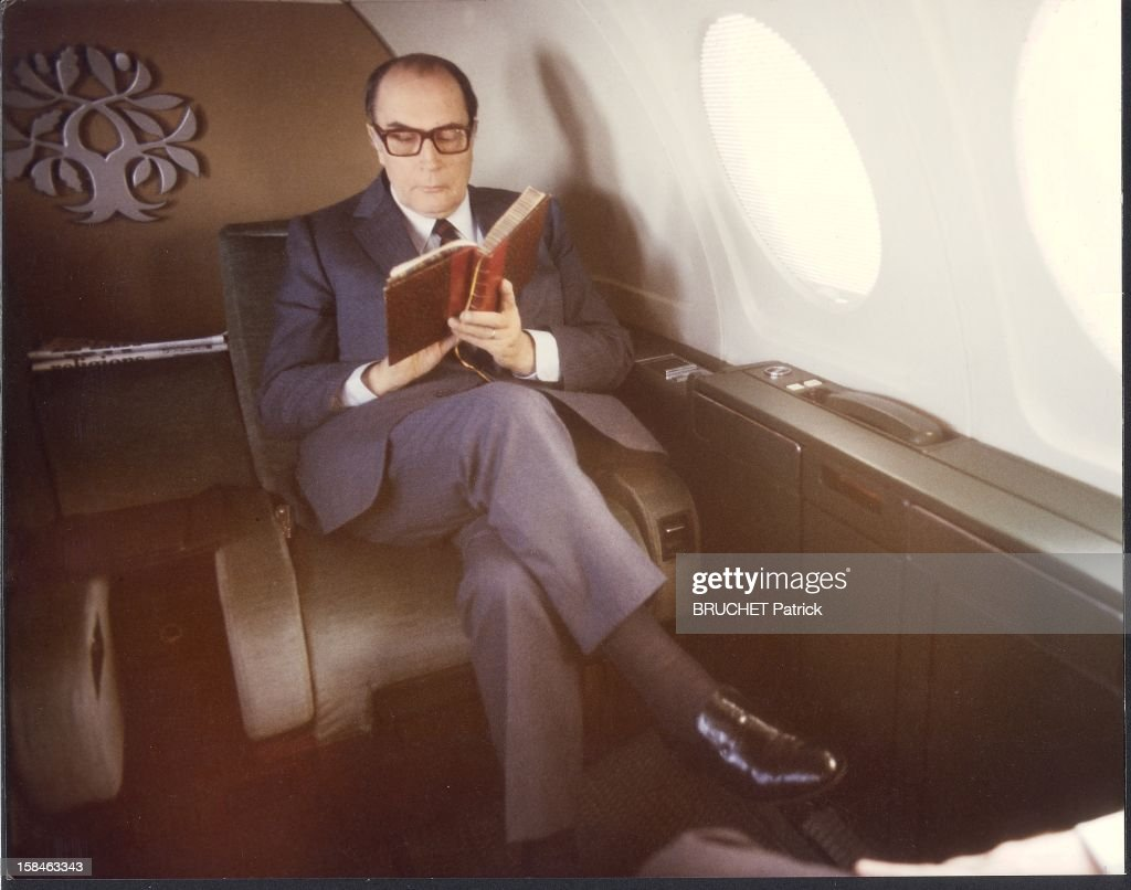 President <a gi-track='captionPersonalityLinkClicked' href=/galleries/search?phrase=Francois+Mitterrand&family=editorial&specificpeople=208938 ng-click='$event.stopPropagation()'>Francois Mitterrand</a> reading a book aboard his airplane Myster 50 called 'Rambouillet' returning to Toulouse, where he celebrated the official launch of the Airbus 320. Seen above his head his emblem: oak branches (robustness) and olive (peace) on a common core.
