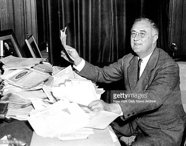President Franklin D Roosevelt reads congratulatory telegrams after reelection victory over Alfred Landon