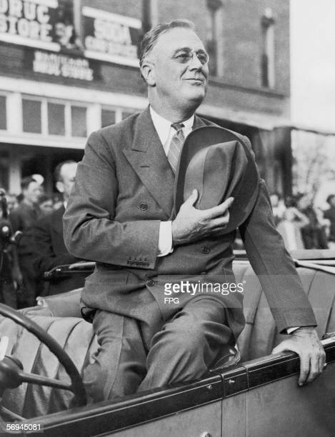 US president Franklin D Roosevelt salutes the flag during a parade circa 1938