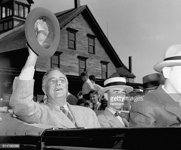 US President Franklin D Roosevelt waves his fedora in salute to Rockland crowds who greeted him as he landed after his momentous talks on the high...