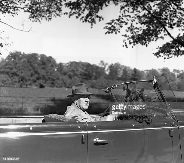 President Franklin Roosevelt takes a leisurely drive with his dog Fala | Location Hyde Park New York USA