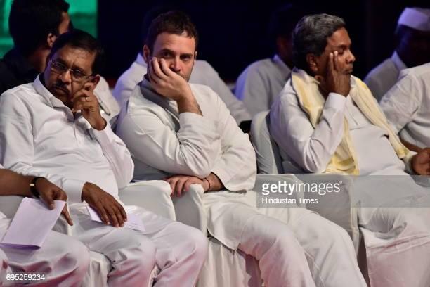 KPCC President G Parameshwara Congress Vice President Rahul Gandhi and Karnataka Chief Minister Siddaramaiah during Congress delegate meeting at...