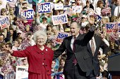 US President George Bush and First Lady Barbara Bush wave to supporters on October 12 1992 at a campaign rally in Springfield Pennsylvania Bush goes...