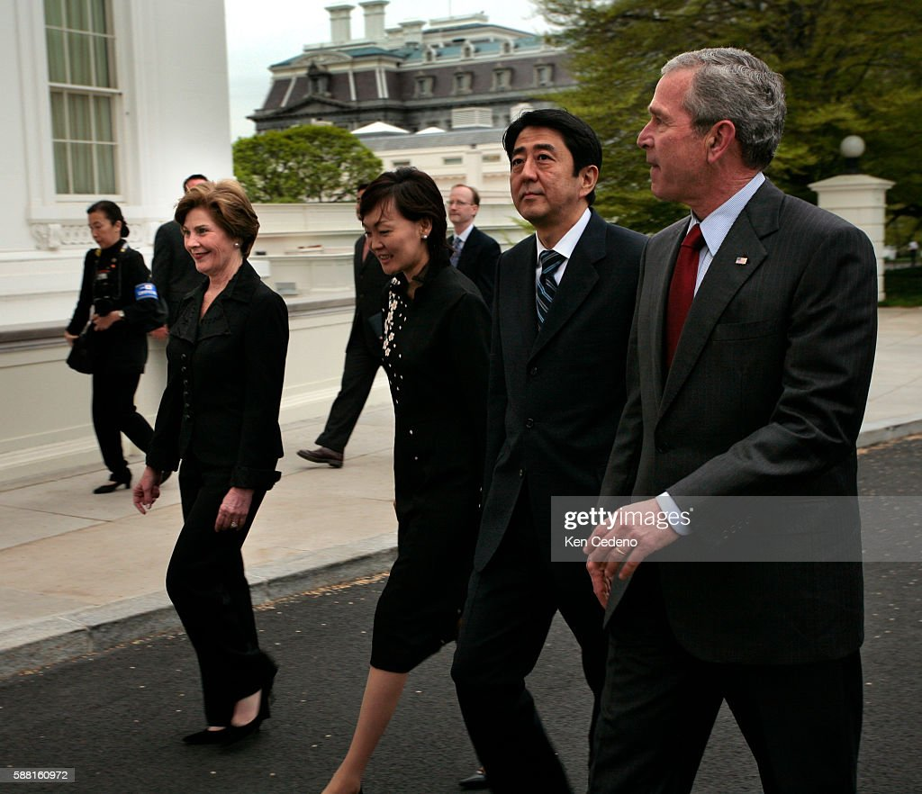 President George Bush and First Lady Laura Bush welcome the Prime Minister of Japan Shinzo Abe and Mrs Abe to the White House North Portico Thursday...