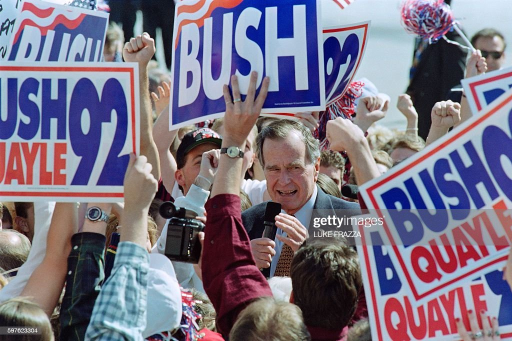 US President George Bush greets supporters upon his arrival on October 11 1992 at Washington University in St Louis for the first presidential debate...