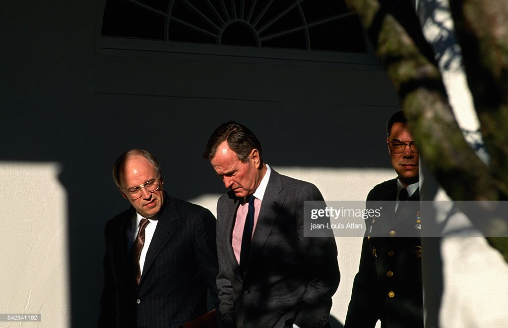 US President George Bush has a private discussion in the grounds of the White House with Defence Secretary Dick Cheney and General Colin Powell US...