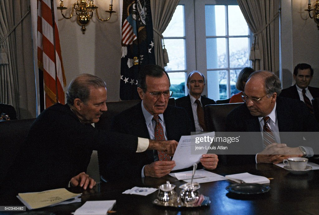 President George Bush holds an emergency meeting with cabinet ministers James Baker and Dick Cheney the day after the US launched its first attack on...