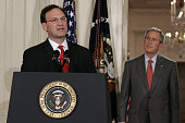 US President George Bush listens as US Supreme Court Justice Samuel Alito delivers remarks after being swornin during a ceremony in the East Room at...