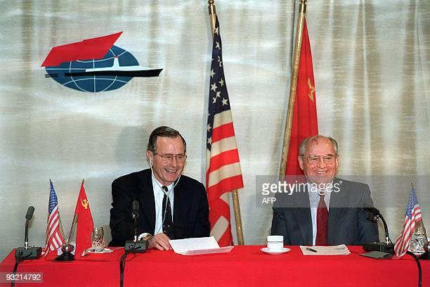 US President George Bush shares a joke with Soviet leader Mikhail Gorbachev on December 03 1989 on board the soviet cruise 'Maxim Gorki' shipdocked...
