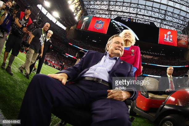 President George HW Bush and Barbara Bush arrive for the coin toss prior to Super Bowl 51 between the Atlanta Falcons and the New England Patriots at...