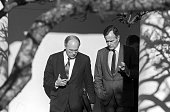 President George HW Bush and Secretary of Defense Dick Cheney discuss the run up to Operation Desert Storm as they walk near the Rose Garden at the...
