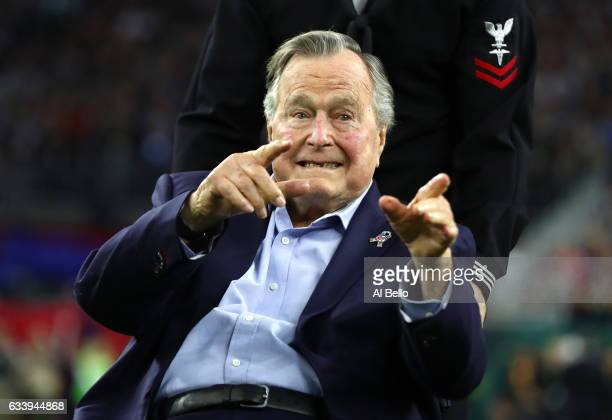 President George HW Bush arrives for the coin toss prior to Super Bowl 51 between the Atlanta Falcons and the New England Patriots at NRG Stadium on...
