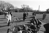 President George HW Bush arriving at the White House aboard Marine One a few days before the inauguration of Bill Clinton prepares to speak with...