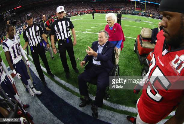 President George HW Bush flips the coin with wife Barbara Bush during Super Bowl 51 between the Atlanta Falcons and the New England Patriots at NRG...