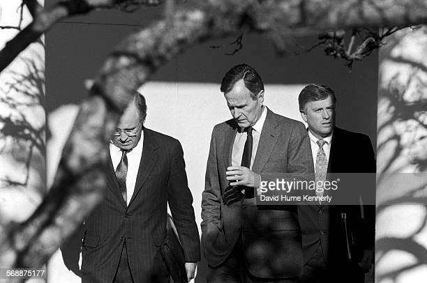 President George HW Bush Secretary of Defense Dick Cheney and Vice President Dan Quayle in the Rose Garden at the White House talk about the visit of...